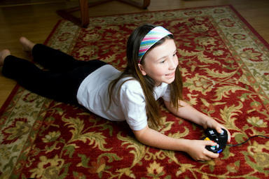 girl playing on clean area rug
